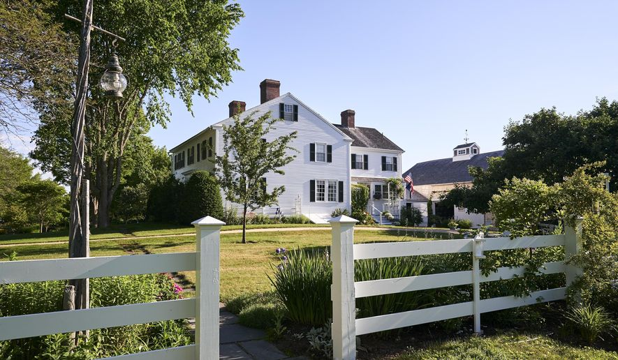 """This July, 13, 2017, photo provided by Yankee Magazine shows an oceanfront home where E.B. White lived when he penned """"Charlotte's Web."""" The home where White lived until his death in 1985 dates to the late 1700s and includes a barn that was the setting for the beloved children's book featuring a pig named Wilbur and a spider named Charlotte. (Mark Fleming/Yankee Magazine via AP)"""