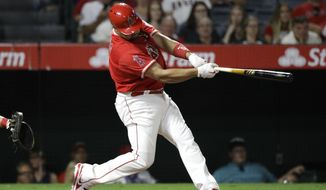 Los Angeles Angels' Albert Pujols hits a three-run home run during the seventh inning of the team's baseball game against the Philadelphia Phillies, Tuesday, Aug. 1, 2017, in Anaheim, Calif. (AP Photo/Jae C. Hong)
