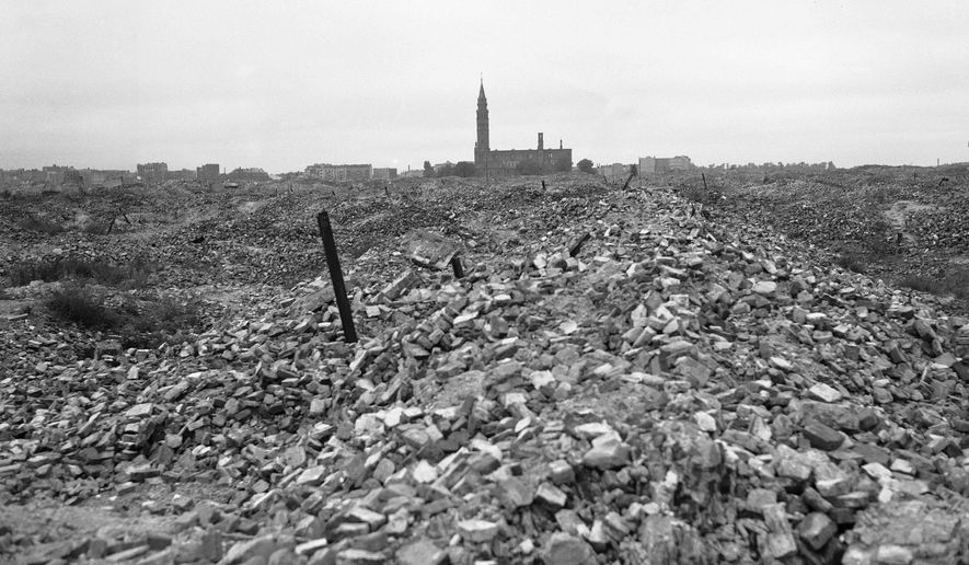 """This file photo from 1945 shows the remains of the Warsaw ghetto, which the German SS dynamited to the ground. A Polish ruling party official said Wednesday that Poland is considering demanding reparations from Germany for the massive losses inflicted on Poland during World War II. Ruling party leader Jaroslaw Kaczynski recently said Poland planned a """"counter-offensive"""" against Germany, accusing the neighbor of avoiding responsibility for its war-era crimes. (AP Photo/B.I. Sanders)"""