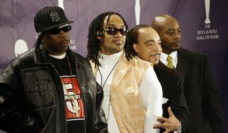 In this March 12, 2007, file photo, The Furious Five, from left, Scorpio, Melle Mel, Kidd Creole and Rahiem appear in the press room at the Rock & Roll Hall of Fame induction ceremony in New York. Police say 57-year-old Nathaniel Glover, also known as The Kidd Creole, was arrested Wednesday night, Aug. 2, 2017, on murder charges. (AP Photo/Stuart Ramson, File)