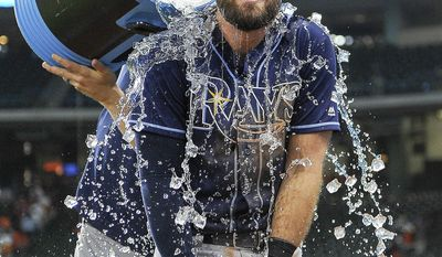 Tampa Bay Rays' Evan Longoria is doused with liquid by Steven Souza Jr. after the team's 6-4 win over the Houston Astros, Tuesday, Aug. 1, 2017, in Houston. Longoria became the second Tampa Bay player to hit for the cycle and drove in three runs to lead the Rays over the Houston Astros 6-4 on Tuesday night. (AP Photo/Eric Christian Smith)