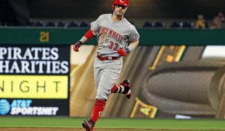 Cincinnati Reds' Jesse Winker rounds second after hitting a solo home run off Pittsburgh Pirates relief pitcher Joaquin Benoit during the seventh inning of a baseball game in Pittsburgh, Wednesday, Aug. 2, 2017. (AP Photo/Gene J. Puskar)