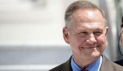 FILE - In this April 26, 2017 file photo, former Alabama Chief Justice Roy Moore smiles before announcing his candidacy for U.S. Senate in Montgomery, Ala. Moore, who was twice removed from his duties after losing battles on gay marriage and the public display of the Ten Commandments, is in a heated Republican primary with incumbent Sen. Luther Strange and Congressman Mo Brooks. (Albert Cesare/The Montgomery Advertiser via AP, File)