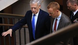 Defense Secretary Jim Mattis, left, leaves after a closed-door briefing with the Senate Foreign Relations Committee regarding the administration's perspective on the authorizations for the use of military force on Wednesday, Aug. 2, 2017, on Capitol Hill in Washington. (AP Photo/Manuel Balce Ceneta)