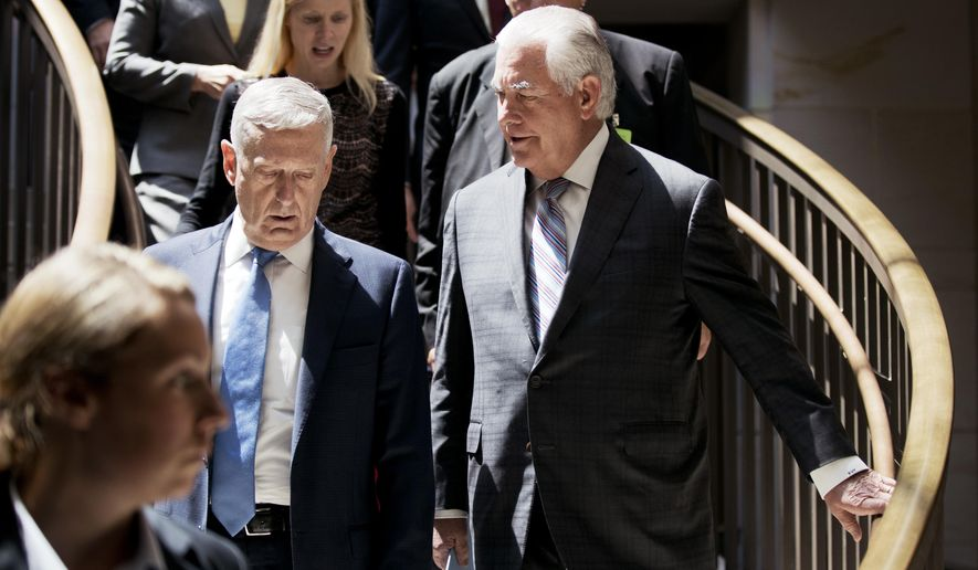 Secretary of State Rex Tillerson, right, and Defense Secretary of Defense Jim Mattis, arrive on Capitol Hill in Washington, Wednesday, Aug. 2, 2017, to brief the Senate Foreign Relations Committee behind closed-doors regarding the administration's perspective on the authorizations for the use of military force. (AP Photo/Manuel Balce Ceneta)