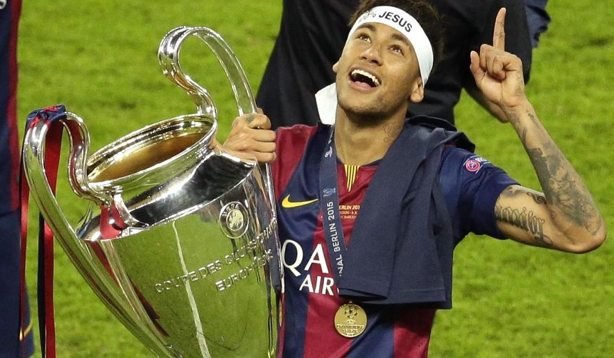 FILE - In this Saturday, June 6, 2015 file photo, Barcelona's Neymar celebrates with the trophy after the Champions League final soccer match between Juventus Turin and FC Barcelona at the Olympic stadium in Berlin. Barcelona said, Wednesday, Aug. 2, 2017, Neymar's 222 million euro ($262 million) release clause must be paid in full if the Brazil striker wants to leave. (AP Photo/Michael Sohn, File)