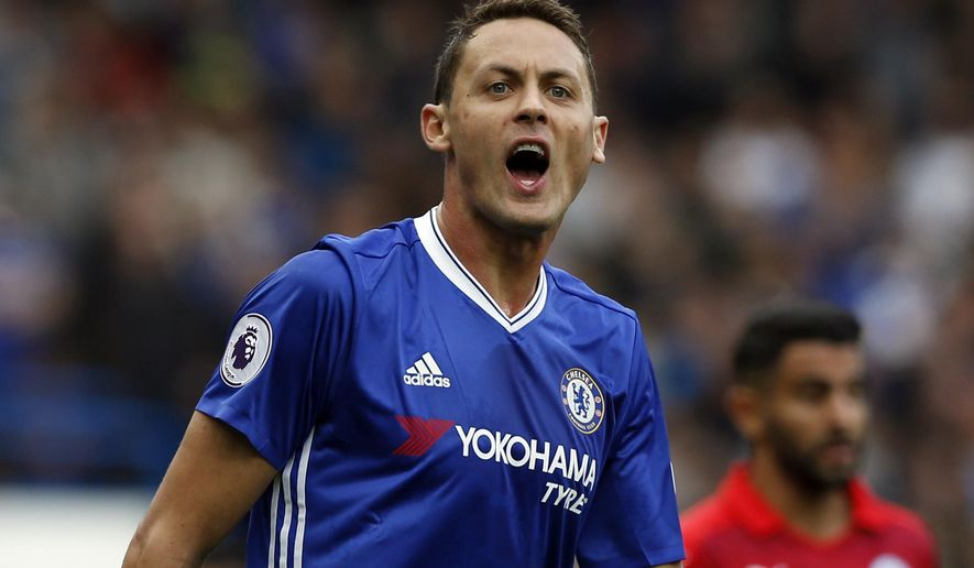 FILE - In this Saturday, Oct. 15, 2016 file photo, Chelsea's Nemanja Matic shouts to his teammates during the English Premier League soccer match between Chelsea and Leicester City, at Stamford Bridge stadium in London. Manchester United signed midfielder Nemanja Matic from Chelsea on Monday, July 31, 2017 on a three-year contract. (AP Photo/Alastair Grant, File)