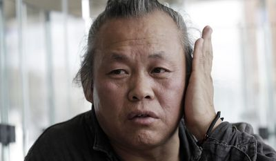 FILE - In this Oct. 3, 2015 photo, South Korean director Kim Ki-duk speaks during an interview at the Busan International Film Festival in Busan, South Korea. South Korean prosecutors are investigating award-winning film director Kim Ki-duk after an actress accused him of hitting her and trying to force her into shooting off-script sexual scenes while making a 2013 movie. (AP Photo/Ahn Young-joon, File)