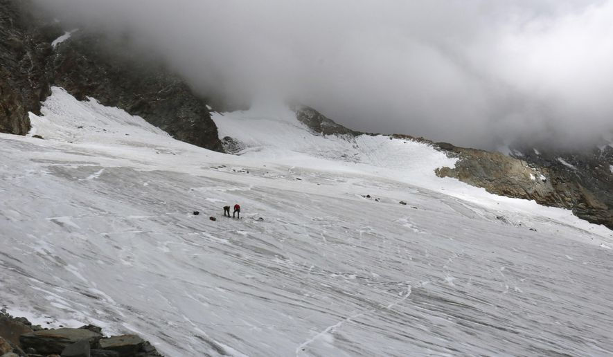 This undated  picture released by the police in canton Valais shows the place at Hohlaub Glacier near Saas Fee, Switzerland where the body of a German hiker was found.  The remains of the  German hiker who disappeared while climbing in the Swiss Alps 30 years ago has been found at the Hohlaubgletscher above Saas Fee, Switzerland, on July 25 2017 by two climbers, police said on Wednesday, Aug. 2,  2017.  (Police of Canton Valais/Keystone via AP)