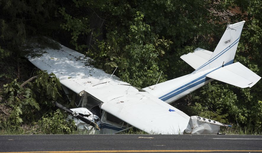 A downed aircraft lays off the shoulder of U.S. Highway 69, north of Mount Selman, Texas, Tuesday, Aug. 1, 2017. The small engine plane had two occupants. Injuries are unknown at this time, according to an email from The Texas Department of Public Safety. (Sarah A. Miller/Tyler Morning Telegraph via AP)
