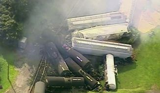 In this aerial image made from a video provided by WPXI, smoke rises in the air after dozens of cars of a freight train carrying hazardous materials derailed in Hyndman, Pa., Wednesday, Aug. 2, 2017. County officials ordered all residents of the small Pennsylvania town to evacuate after the derailment. (WPXI via AP)