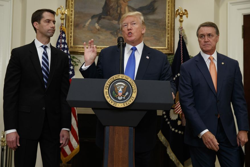 President Donald Trump, flanked by Sen. Tom Cotton, R- Ark., left, and Sen. David Perdue, R-Ga., speaks in the Roosevelt Room of the White House in Washington, Wednesday, Aug. 2, 2017, during the unveiling of legislation that would place new limits on legal immigration. (AP Photo/Evan Vucci) ** FILE **