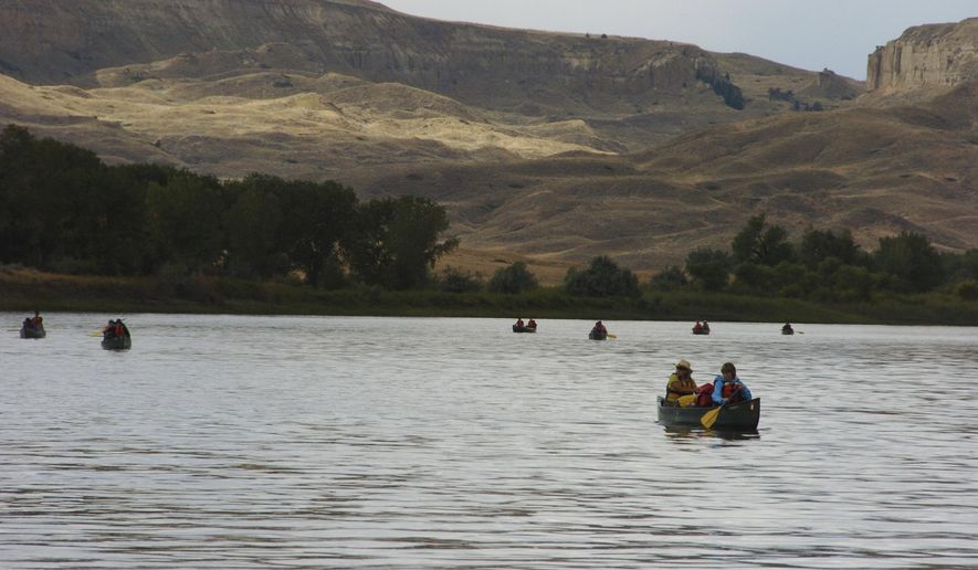 FILE - In this Sept. 19, 2011 file photo, a group canoes through the Upper Missouri River Breaks National Monument near Fort Benton, Mont. Interior Secretary Ryan Zinke says he will not recommend changes to Montana's Upper Missouri River Breaks National Monument as he continues to review national monuments for possible elimination or reduction.  (AP Photo/Matthew Brown, File)