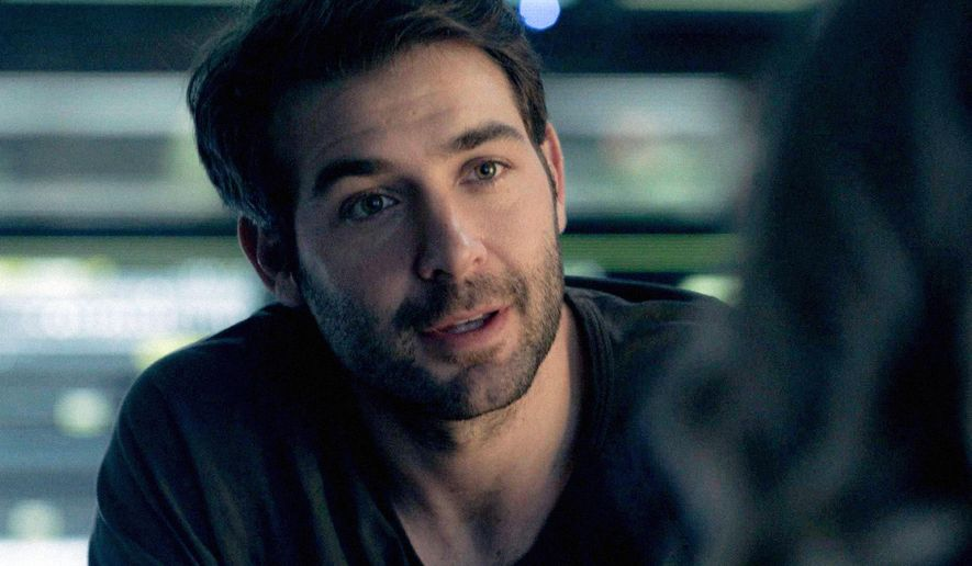 "This image from video released by CBS shows James Wolk in a scene from, ""Zoo,"" a series about wild animals attacking humans  (CBS via AP)"
