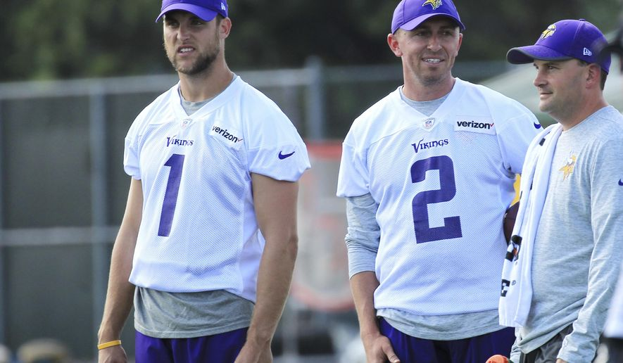 FILE - In this July 27, 2017, file photo, Minnesota Vikings kicker Marshall Koehn (1) and Vikings kicker Kai Forbath (2) watch practice during NFL football training camp,in Mankato, Minn. After the Vikings made a midseason switch from Blair Walsh last year, Kai Forbath came in and made all of his field goal tries. But he has not been given the job for 2017 yet. Marshall Koehn is trying to take it. Person at right is unidentified. (AP Photo/Andy Clayton-King)