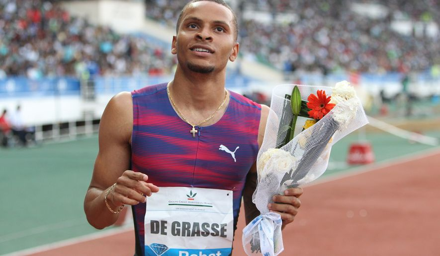 FILE - In this July 16, 2017 file photo, Canadian De Grasse Andre celebrates after winning the men's 200-meter at the International Mohammed VI track and field meeting in Rabat, Morocco. Athletics Canada issued a statement late Wednesday, Aug. 2, 2017 saying the 22-year-old sprinter hurt his hamstring in training on Monday and made the decision to pull out of the championships after a second medical examination on Wednesday. (AP Photo/Abdeljalil Bounhar, File)