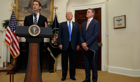 """We want to welcome talented individuals from around the world who wish to come to the United States legally,"" said Sen. David Perdue (right). (Associated Press)"