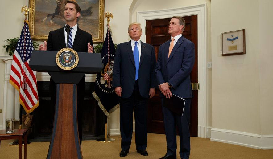 """""""We want to welcome talented individuals from around the world who wish to come to the United States legally,"""" said Sen. David Perdue (right). (Associated Press)"""