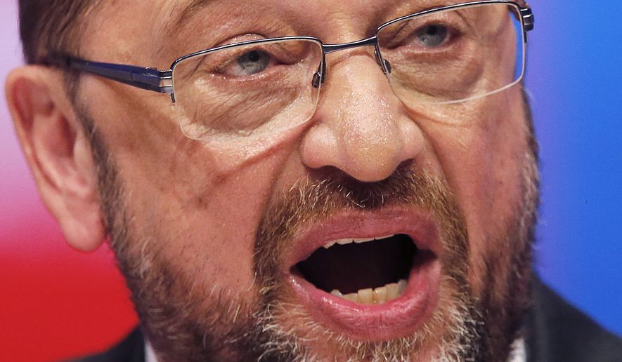In this June 25, 2017, file photo, Social Democrats' leader and top candidate for the German elections in September Martin Schulz speaks during a meeting of Germany's Social Democratic Party in Dortmund, Germany. Chancellor Angela Merkel's challenger in Germany's Sept. 24 election is quoted Thursday, Aug. 3, 2017 telling Der Spiegel magazine he is suggesting that he would be better at standing up to President Donald Trump than the longtime German leader. (AP Photo/Michael Probst,file)