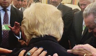 Pastors praying over President Donald Trump in the Oval Office. (Image: Johnnie Moore's Twitter page/@JohnnieM)