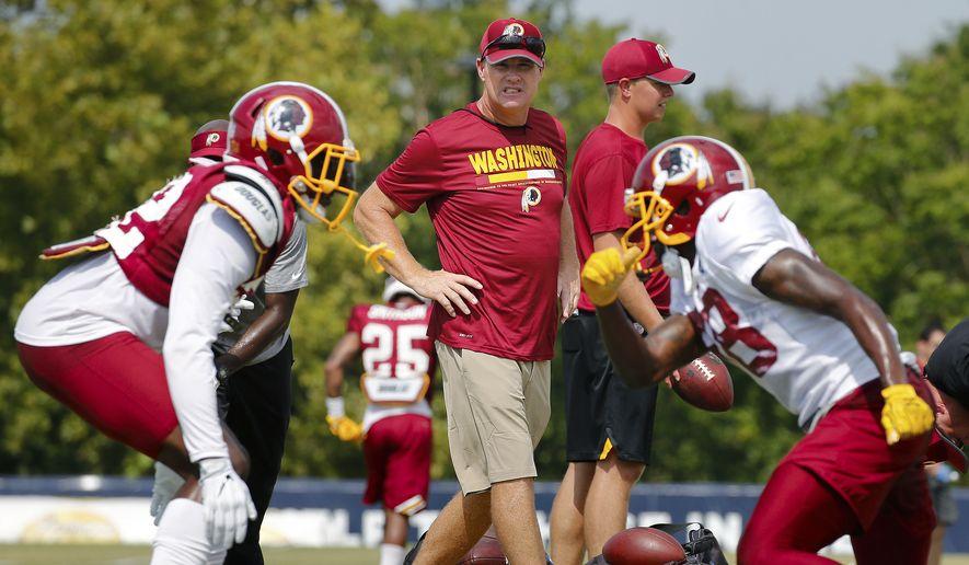 Washington Redskins' head coach Jay Gruden watches during NFL training camp, Thursday, Aug. 3, 2017 in Richmond, Va. (Mark Gormus/Richmond Times-Dispatch via AP)