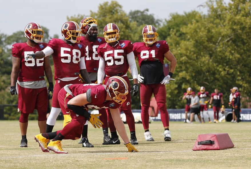 Washington Redskins' Trent Murphy prepares to run a drill as other linebackers look on during NFL training camp, Thursday, Aug. 3, 2017 in Richmond, Va. (Mark Gormus/Richmond Times-Dispatch via AP)