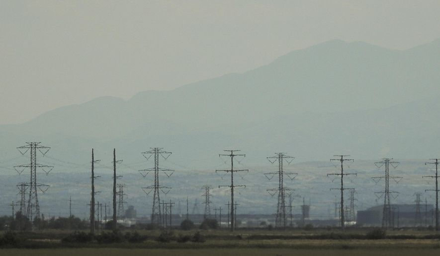 In this Tuesday, Aug. 1, 2017 a layer of smog hangs over the Salt Lake City area. Ozone levels in northern Utah's murky summer air have reached their worst levels in nearly 10 years this summer amid hot temperatures and high-pressure systems, the Salt Lake Tribune reported. (Francisco Kjolseth/The Salt Lake Tribune via AP)