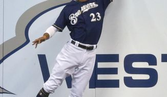 Milwaukee Brewers' Keon Broxton catches a ball off the bat of St. Louis Cardinals' Jose Martinez during the second inning of a baseball game Thursday, Aug. 3, 2017, in Milwaukee. (AP Photo/Jeffrey Phelps)