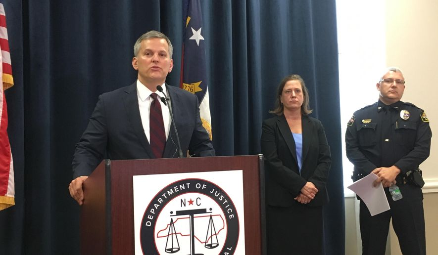 North Carolina Attorney General Josh Stein speaks to reporters on Thursday, Aug. 3, 2017, in Raleigh, N.C. Stein describes his decision to lay off about 9 percent of his agency's attorneys as well as about two dozen other staffers as a result of a $10 million budget cut forced on the Democrat by the Republican-dominated General Assembly. (AP Photo/Emery Dalesio)