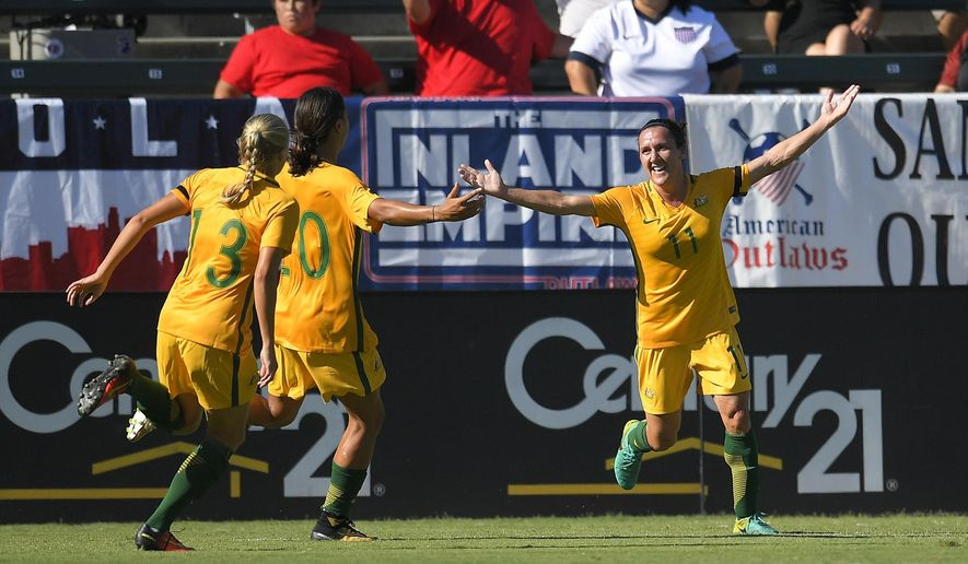 Australia's Lisa De Vanna, right, celebrates with teammates Temeka Butt, left, and Sam Kerr after scoring during the first half of the team's Tournament of Nations soccer match against Brazil, Thursday, Aug. 3, 2017, in Carson, Calif. (AP Photo/Mark J. Terrill)
