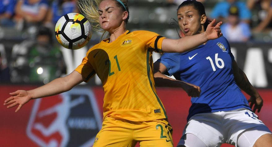 Australia's Ellie Carpenter, left, looks to control the ball in front of Brazil's Bia Zaneratto during the first half of a Tournament of Nations soccer match, Thursday, Aug. 3, 2017, in Carson, Calif. (AP Photo/Mark J. Terrill)