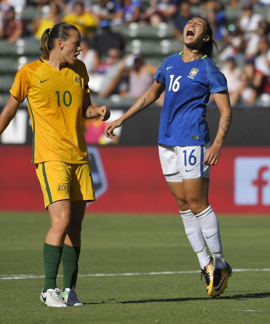 Brazil's Bia Zaneratto, right, reacts after missing a shot as Australia's Emily Van Egmond watches during the first half of a Tournament of Nations soccer match, Thursday, Aug. 3, 2017, in Carson, Calif. (AP Photo/Mark J. Terrill)