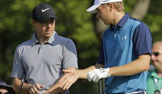 Jordan Spieth, right, and Rory McIlroy, from Northern Ireland, talk before teeing off on the 14th hole during the first round of the Bridgestone Invitational golf tournament at Firestone Country Club, Thursday, Aug. 3, 2017, in Akron, Ohio. (AP Photo/Tony Dejak)