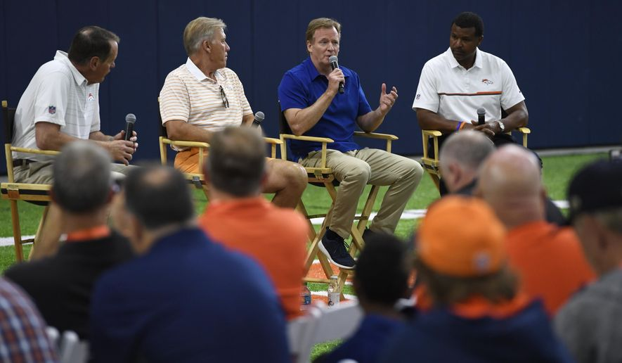 NFL commissioner Roger Goodall, second from right, speaks during a fan forum at the Denver Broncos indoor training facility, Thursday, Aug. 3, 2017 in Englewood, Colo. The voice of the Denver Broncos Dave Logan, left, Denver Broncos president of football operations/general manager John Elway, second from left, and and former Denver Broncos great Steve Atwater, right,  also answered questions from the fans (Andy Cross/The Denver Post via AP)