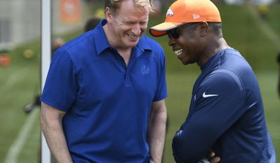 NFL commissioner Roger Goodall, left, has a laugh with Denver Broncos head coach Vance Joseph during NFL football practice, Thursday, Aug. 3, 2017 in Englewood, Colo. (Andy Cross/The Denver Post via AP)
