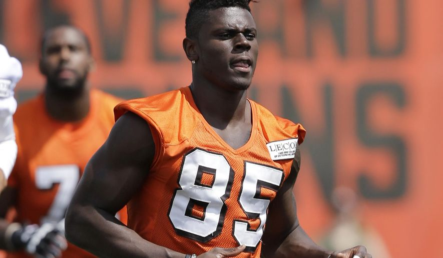 FILE - In this July 28, 2017, file photo, Cleveland Browns tight end David Njoku (85) warms up at practice at the NFL football team's training camp facility, in Berea, Ohio. The first-round draft pick from Miami had better get it together as Cleveland is counting on him to contribute this season. (AP Photo/Tony Dejak, File)