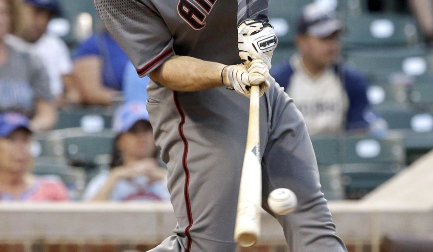 Arizona Diamondbacks' Paul Goldschmidt hits a solo home run against the Chicago Cubs during the ninth inning of a baseball game Thursday, Aug. 3, 2017, in Chicago. (AP Photo/Nam Y. Huh)