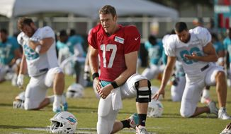 Miami Dolphins quarterback Ryan Tannehill stretches out during an NFL football training camp, Thursday, Aug. 3, 2017, at the Dolphins training facility in Davie, Fla. (AP Photo/Wilfredo Lee)
