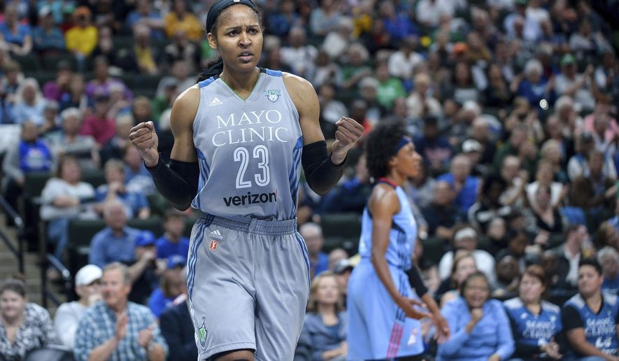 Minnesota Lynx forward Maya Moore (23) celebrates after forcing an turnover by the Atlanta Dream during the first quarter of a WNBA basketball game Thursday, Aug. 3, 2017, in St. Paul, Minn. (Aaron Lavinsky/Star Tribune via AP)