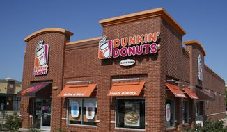"This Thursday, July 28, 2016, file photo shows a Dunkin' Donuts in Edmond, Okla. Dunkin' is thinking about dumping ""Donuts"" from its name. A new location in Pasadena, Calif., will be called simply Dunkin', a move that parent company Dunkin' Brands Inc. calls a test. The Canton, Mass.-based company says a few other stores will get the one-name treatment too. (AP Photo/Sue Ogrocki, File)"