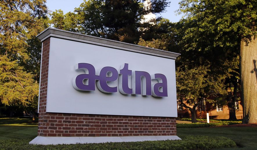 This Thursday, June 1, 2017, photo, shows a sign on the campus of the Aetna headquarters, in Hartford, Conn. Aetna Inc. reports earnings, Thursday, Aug. 3, 2017. (AP Photo/Bill Sikes)