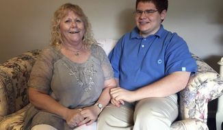 ADVANCE FOR SATURDAY AUG 5 AND THEREAFTER - In a July 14, 2017 photo, Matt Love and his mother, Joyce, pose for a photo at their home in Blackwood, NJ.  Matt attended Camden County Technical Schools. In 10th grade, he entered the pre-engineering academy, and before long was ranked No. 1 academically out of 322 students in the Class of 2017. (Kathy Boccella/The Philadelphia Inquirer via AP)