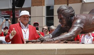 ADVANCE FOR USE SATURDAY, AUG. 5, 2017 AND THEREAFTER - FILE - In this June 17, 2017 file photo, Former Cincinnati Reds player Pete Rose smiles during the dedication of his statue outside Great American Ballpark in Cincinnati. When sculptor Tom Tsuchiya was commissioned for his eighth work, the statue of Rose, he knew exactly what it had to be, Rose had to be diving into a base. The problem was how to create something that heavy with so much of it unsupported in the air. Dean Solberg, a Lakewood, Ill., resident and co-owner of Exact Metrology, which does 3-D laser and CT scanning, played an integral role in the creation of Tsuchiya's statue. (AP Photo/John Minchillo)