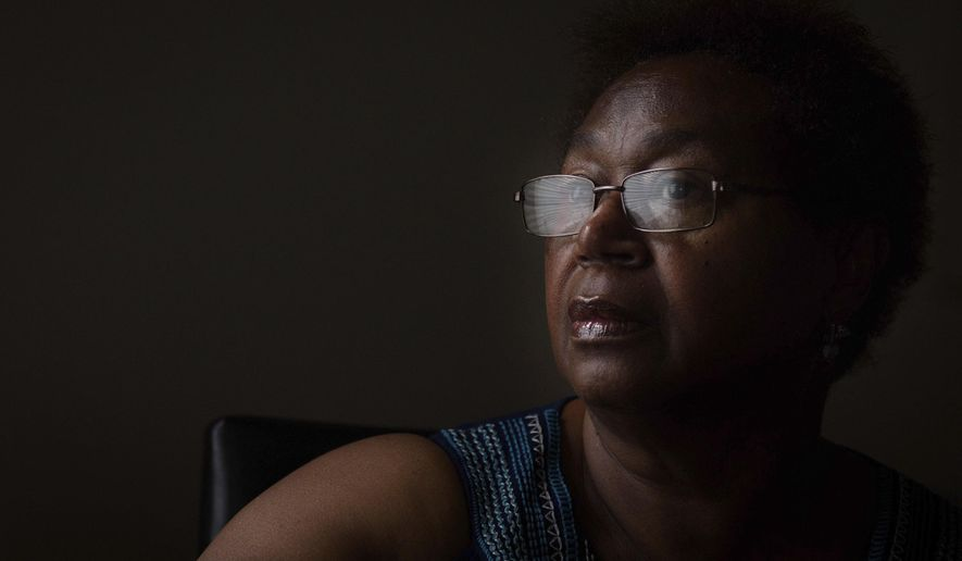 FOR RELEASE SUNDAY, AUGUST 6, 2017, AT 12:01 A.M. EDT.-Lola Smith was finally able to move back into her apartment at First Baptist homes in Lumberton, N.C, after spending months living in a hotel. (Andrew Craft /The Fayetteville Observer via AP)