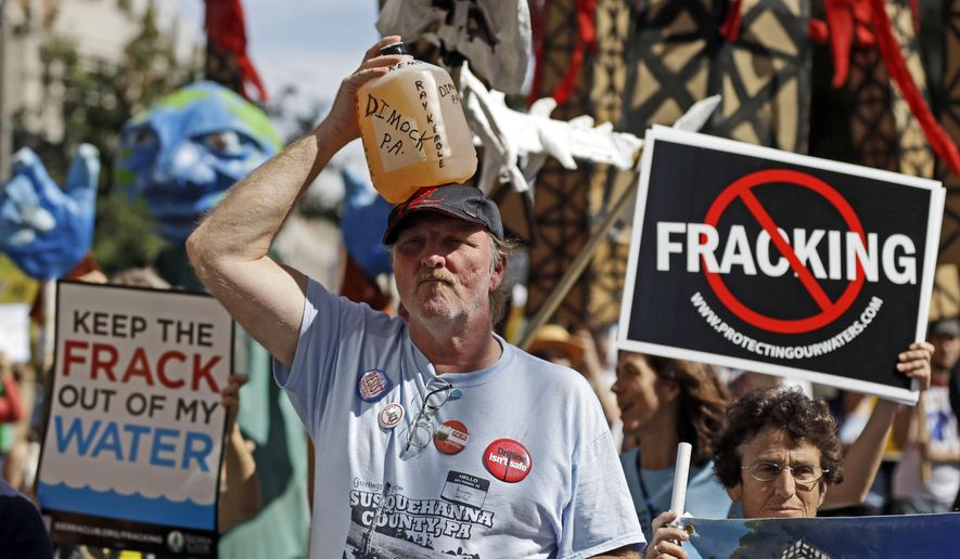 FILE – In this Sept. 20, 2012 file photo, Ray Kemble, of Dimock, Pa., holds a jug of his well water on his head while marching with demonstrators against hydraulic fracturing outside a Marcellus Shale industry conference in Philadelphia. Federal government scientists are collecting water and air samples in the first week of August 2017 from about 25 homes in Dimock, Pa., a tiny, rural crossroads about 150 miles north of Philadelphia that became a flashpoint in the national debate over fracking to investigate ongoing complaints about the quality of the drinking water. (AP Photo/Matt Rourke, File)