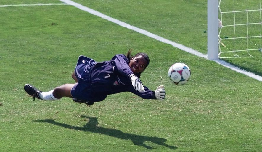FILe - In this July 10, 1999, file photo, United States' goal keeper Briana Scurry (1) blocks a penalty shootout kick by China's Ying Liu during overtime of the Women's World Cup Final at the Rose Bowl in Pasadena, Calif. Scurry was elected to the National Soccer Hall of Fame, Thursday, Aug. 3, 2017.  (AP Photo/Eric Risberg, File)