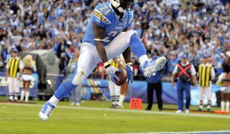 FILE - In this Nov. 29, 2009, file photo, San Diego Chargers running back LaDainian Tomlinson celebrates his second touchdown during the third quarter of an NFL football game against the Kansas City Chiefs, in San Diego, Calif. Tomlinson will be inducted into the Pro Football Hall of Fame on Saturday, Aug. 5, 2017. (AP Photo/Chris Carlson, File)