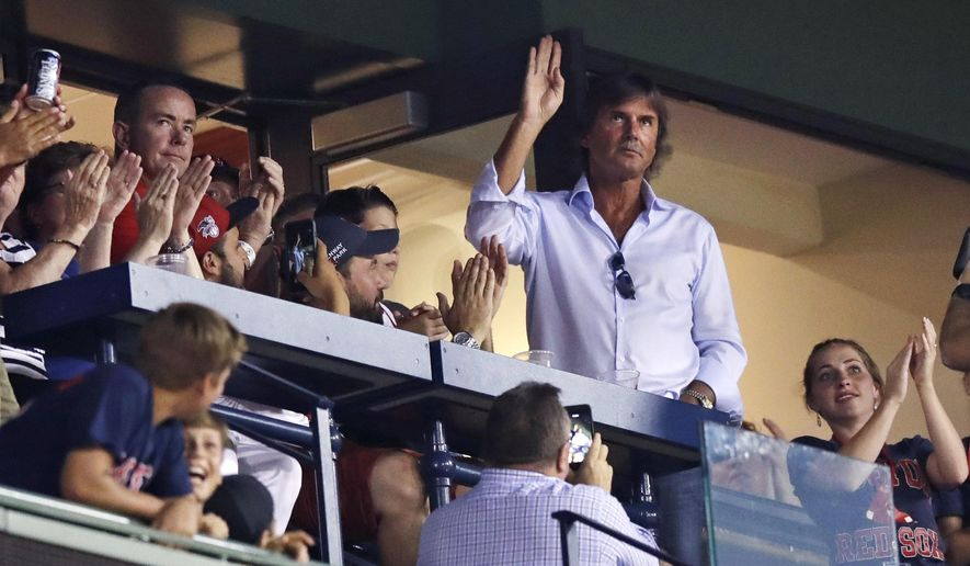 Hall of Fame pitcher Dennis Eckersley waves as fans applaud when he is honored between innings of a baseball game between the Boston Red Sox and Cleveland Indians at Fenway Park, Tuesday, Aug. 1, 2017, in Boston. Red Sox pitcher David Price was still frustrated Saturday over Eckersley's critical comments about some of his teammates. (AP Photo/Charles Krupa)