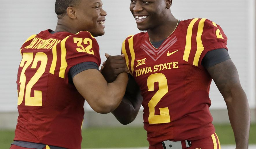 Iowa State running back David Montgomery, left, laughs with teammate running back Mike Warren, right, during Iowa State's annual NCAA college football media day, Thursday, Aug. 3, 2017, in Ames, Iowa. (AP Photo/Charlie Neibergall)