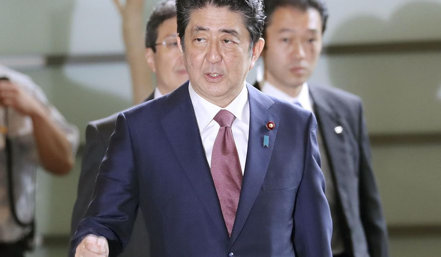 Japan's Prime Minister Shinzo Abe enters his official residence in Tokyo Thursday, Aug. 3, 2017. Abe will reshuffle his Cabinet to replace some of his scandal-hit ministers in hopes of regaining public support. (AP Photo/Eugene Hoshiko)